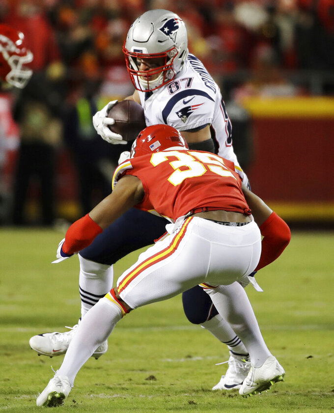 New England Patriots tight end Rob Gronkowski (87) makes a catch against Kansas City Chiefs cornerback Charvarius Ward (35) during the first half of the AFC Championship NFL football game, Sunday, Jan. 20, 2019, in Kansas City, Mo. (AP Photo/Elise Amendola)