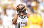 Georgia Tech quarterback Jordan Yates (13) looks to pass the ball against Kennesaw State during the first half of an NCAA college football game, Saturday, Sept. 11, 2021, in Atlanta. (AP Photo/Brynn Anderson)