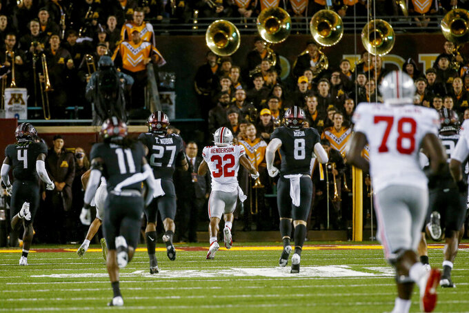 Ohio State running back TreVeyon Henderson (32) runs toward the Minnesota band and a touchdown on a 70-yard pass play during the fourth quarter of an NCAA college football game Thursday, Sept. 2, 2021, in Minneapolis. Ohio State won 45-31. (AP Photo/Bruce Kluckhohn)