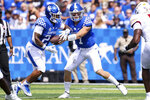 Kentucky quarterback Will Levis (7) hands the ball off to Chris Rodriguez Jr. (24) during the first half of an NCAA college football game against Louisiana-Monroe in Lexington, Ky., Saturday, Sept. 4, 2021. (AP Photo/Michael Clubb)