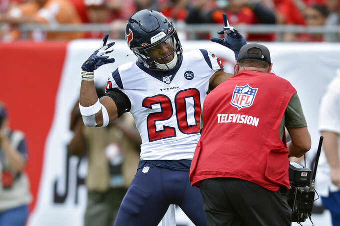 Houston Texans strong safety Justin Reid (20) celebrates for the cameras after intercepting a pass by Tampa Bay Buccaneers quarterback Jameis Winston during the first half of an NFL football game Saturday, Dec. 21, 2019, in Tampa, Fla. (AP Photo/Jason Behnken)