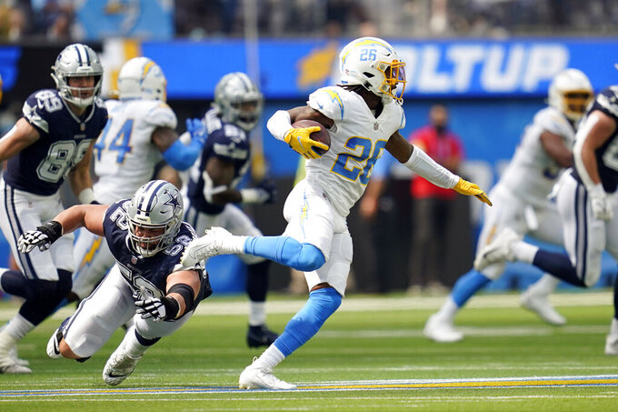 Los Angeles Chargers cornerback Asante Samuel Jr., center, intercepts a pass against the Dallas Cowboys during the first half of an NFL football game Sunday, Sept. 19, 2021, in Inglewood, Calif. (AP Photo/Ashley Landis )