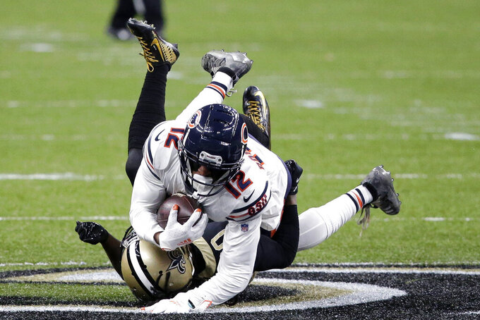 Chicago Bears wide receiver Allen Robinson (12) is tackled by New Orleans Saints cornerback Janoris Jenkins in the second half of an NFL wild-card playoff football game in New Orleans, Sunday, Jan. 10, 2021. (AP Photo/Butch Dill)