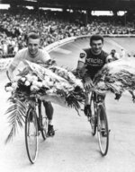 FILE - This July 14, 1964 file picture shows French cycling ace Jacques Anquetil, left, winning for the fifth time the Tour de France, as he rides an honor round with the Tour's second, Raymond Poulidor, at the Parc des Princes stadium in Paris, France. Tour de France organizers have confirmed that former rider Raymond Poulidor, known as