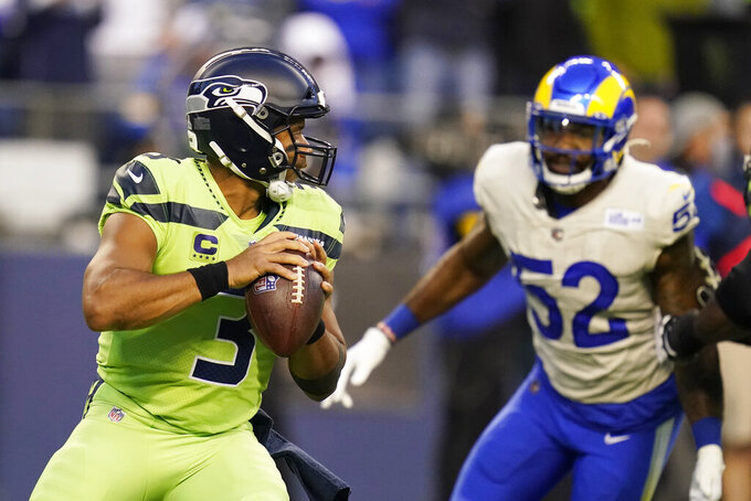 Seattle Seahawks quarterback Russell Wilson (3) passes against the Los Angeles Rams during the first half of an NFL football game, Thursday, Oct. 7, 2021, in Seattle. (AP Photo/Elaine Thompson)