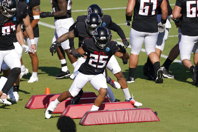 Atlanta Falcons running back Ito Smith (25) runs a drill during an NFL football practice Tuesday, Aug. 18, 2020, in Flowery Branch, Ga. (AP Photo/John Bazemore, Pool)