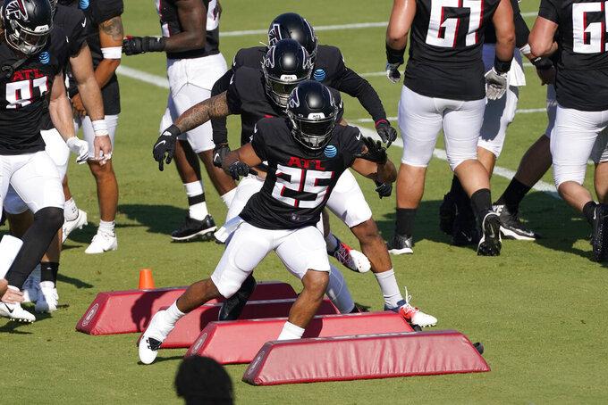Atlanta Falcons running back Ito Smith (25) runs a drill during an NFL football practice Tuesday, Aug. 18, 2020, in Flowery Branch, Ga. (AP Photo/John Bazemore, Pool)
