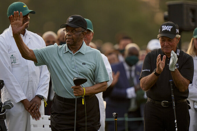Lee Elder waves with Gary Player before the ceremonial first tee the first round of the Masters golf tournament on Thursday, April 8, 2021, in Augusta, Ga. (AP Photo/Matt Slocum)