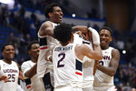 Connecticut's Christian Vital, top left, Connecticut's James Bouknight, front center, and Connecticut's Brendan Adams, back right, congratulate Connecticut's Isaiah Whaley at the end of an NCAA college basketball game against Central Florida, Wednesday, Feb. 26, 2020, in Hartford, Conn. (AP Photo/Jessica Hill)