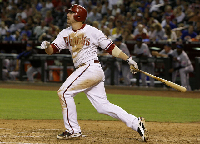 "FILE - In this July 19, 2010, file photo, Arizona Diamondbacks' Mark Reynolds watches his three-run home run against the New York Mets during the sixth inning of a baseball game in Phoenix. Reynolds is retiring after hitting 298 homers over 13 seasons with eight teams. The 36-year-old made the announcement Thursday, April 9, 2020, on SiriusXM Radio. When the free agent was asked whether he still was pursuing a new team, Reynolds said he's ""moved beyond that, I've retired."" He added that he's enjoying spending time with his family and it was time for him ""to find something else to do."" (AP Photo/Ross D. Franklin, File)"