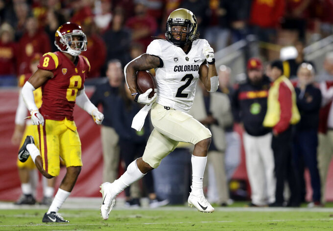 Colorado wide receiver Laviska Shenault Jr. runs for a touchdown after a reception, past Southern California cornerback Iman Marshall (8) during the first half of an NCAA college football game Saturday, Oct. 13, 2018, in Los Angeles. (AP Photo/Marcio Jose Sanchez)