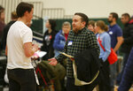 Andrew Kirkland, right, an uncommitted voter, listens to an organizer during the Democratic caucus at Hempstead High School in Dubuque, Iowa, on Monday, Feb. 3, 2020. (Nicki Kohl/Telegraph Herald via AP)