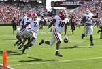 FILE - In this Sept. 8, 2018, file photo, Georgia defensive back Deandre Baker returns an interception for a touchdown during the first quarter during an NCAA college football game against South Carolina in Columbia, S.C. No. 2 Georgia visits No. 13 LSU in a Southeastern Conference intersectional matchup that could impact each division race.  (Curtis Compton/Atlanta Journal-Constitution via AP)