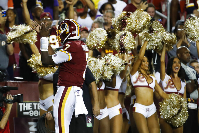 Washington Redskins quarterback Dwayne Haskins (7) celebrates his touchdown pass during the first half of an NFL preseason football game against the Baltimore Ravens, Thursday, Aug. 29, 2019, in Landover, Md. (AP Photo/Alex Brandon)