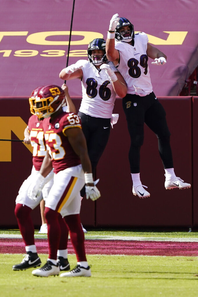 Baltimore Ravens tight end Mark Andrews (89) celebrates his touchdown against the Washington Football Team with Baltimore Ravens tight end Nick Boyle (86) during the second half of an NFL football game, Sunday, Oct. 4, 2020, in Landover, Md. (AP Photo/Susan Walsh)