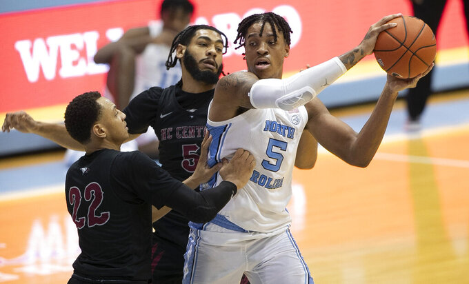 North Carolina Central's Deven Palmer (5) and C.J. Keyser (22) defend against North Carolina's Armando Bacot (5) during the second half of an NCAA college basketball game, Saturday, Dec. 12, 2020, at the Smith Center in Chapel Hill, N.C. (Robert Willett/The News & Observer via AP)