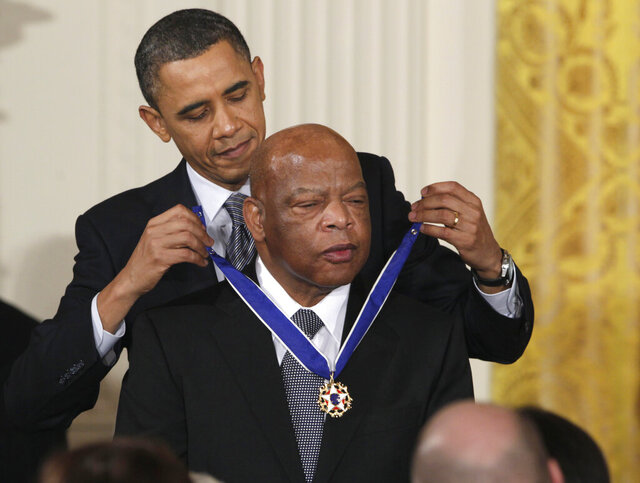 FILE - In this Feb. 15, 2011, file photo, President Barack Obama presents a 2010 Presidential Medal of Freedom to Rep. John Lewis, D-Ga., during a ceremony in the East Room of the White House in Washington. Lewis announced Sunday, Dec. 29, 2019, that he has stage IV pancreatic cancer, vowing he will stay in office and fight the disease with the tenacity which he fought racial discrimination and other inequalities since the civil rights era. (AP Photo/Carolyn Kaster, File)