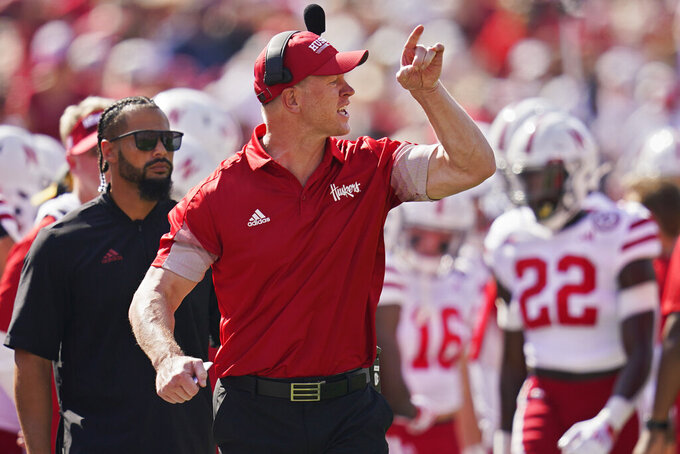 Nebraska head coach Scott Frost gestures on the sidelines in the first half an NCAA college football game against Oklahoma, Saturday, Sept. 18, 2021, in Norman, Okla. (AP Photo/Sue Ogrocki)