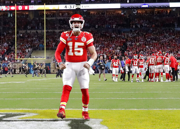 Kansas City Chiefs quarterback Patrick Mahomes (15) gestures before the NFL Super Bowl 54 football game against the San Francisco 49ers Sunday, Feb. 2, 2020, in Miami Gardens, Fla. (AP Photo/Wilfredo Lee)