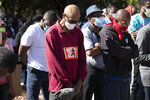 """REMOVES """"UNARMED"""" AND ADDS THAT AUTHORITIES HAVE NOT CONFIRMED THAT ARBERY WAS EITHER ARMED OR UNARMED -  People pray during a rally to  protest the shooting of Ahmaud Arbery, Friday, May 8, 2020, in Brunswick Ga. Two men have been charged with murder in the February shooting death of Arbery,a black man in his mid-20s, whom they had pursued in a truck after spotting him running in their neighborhood. (AP Photo/John Bazemore)"""