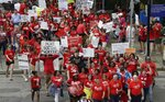 Participants make their way towards the Legislative Building during a teacher's rally at the General Assembly in Raleigh, N.C., Wednesday, May 16, 2018. Thousands of teachers rallied the state capital seeking a political showdown over wages and funding for public school classrooms. (AP Photo/Gerry Broome)