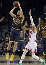 Golden State Warriors' Klay Thompson, left, shoots past Chicago Bulls' Zach LaVine (8) during the first half of an NBA basketball game Friday, Jan. 11, 2019, in Oakland, Calif. (AP Photo/Ben Margot)