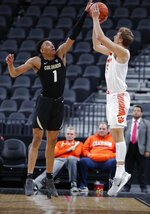 Colorado's Tyler Bey (1) blocks a shot by Clemson's Hunter Tyson (5) during the second half of an NCAA college basketball game, Tuesday, Nov. 26, 2019, in Las Vegas. (AP Photo/John Locher)