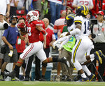 Wisconsin running back Jonathan Taylor make a first-down run against Michigan defensive back Brad Hawkins and defensive back Josh Metellus during the first half of an NCAA college football game Saturday, Sept. 21, 2019, in Madison, Wis. (AP Photo/Andy Manis)