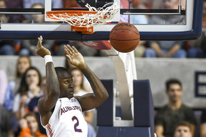 Auburn forward Jaylin Williams (2) dunks against Mississippi during the first half of an NCAA college basketball game Tuesday, Feb. 25, 2020, in Auburn, Ala. (AP Photo/Julie Bennett)
