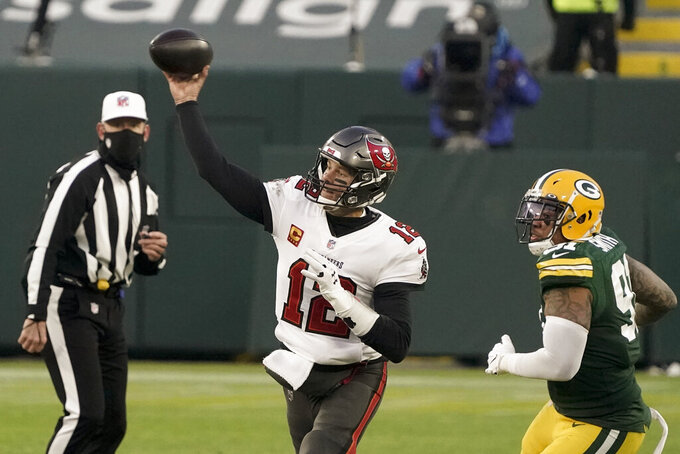 Green Bay Packers' Preston Smith watches as Tampa Bay Buccaneers quarterback Tom Brady throws a pass during the second half of the NFC championship NFL football game in Green Bay, Wis., Sunday, Jan. 24, 2021. (AP Photo/Morry Gash)