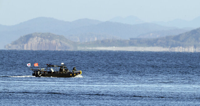 A South Korean marine boat patrols near Yeonpyeong island, South Korea, Sunday, Sept. 27, 2020. North Korea accused South Korea of sending ships across the disputed sea boundary to find the body of a man recently killed by North Korean troops, warning Sunday the alleged intrusion could escalate tensions. (Baek Seung-ryul/Yonhap via AP)