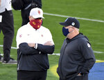 CORRECTS TO PASADENA, INSTEAD OF LOS ANGELES - Southern California coach Clay Helton, left, speaks with UCLA coach Chip Kelly prior to an NCAA college football game Saturday, Dec. 12, 2020, in Pasadena, Calif. (Keith Birmingham/The Orange County Register via AP)