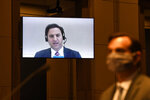 Aaron Zelinsky, on screen, a career Justice Department prosecutor who was part of special counsel Robert Mueller's team and worked on the case against Roger Stone, testifies remotely before the House Judiciary Committee on Capitol Hill in Washington, Wednesday, June 24, 2020, during a hearing on oversight of the Justice Department and a probe into the politicization of the department under Attorney General William Barr. Testifying in person, at right, is John Elias, a career official in the Justice Department's antitrust division. (AP Photo/Susan Walsh,Pool)