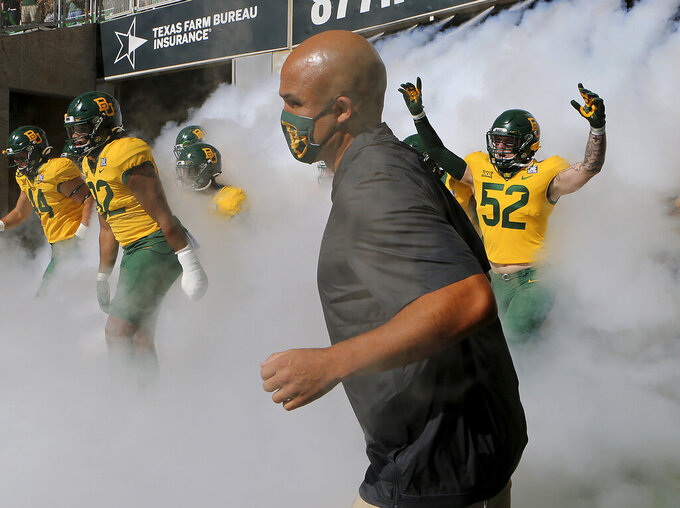FILE - In this Oct. 31, 2020, file photo, Baylor coach Dave Aranda takes the field with his team before an NCAA college football game against TCU in Waco, Texas. The Baylor Bears may start to feel a bit more normal on the field this season. They first had to get through coach Dave Aranda's initial season without any spring drills because of the pandemic that shortened and altered his debut. (Jerry Larson/Waco Tribune-Herald via AP, File)