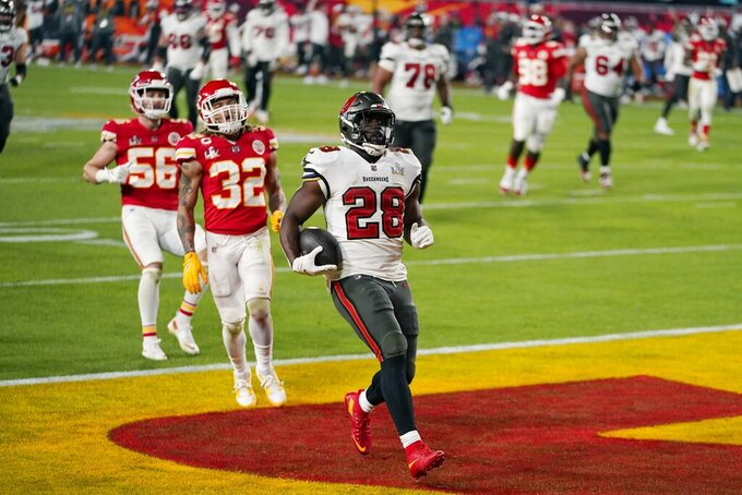 Tampa Bay Buccaneers running back Leonard Fournette scores against the Kansas City Chiefs during the second half of the NFL Super Bowl 55 football game Sunday, Feb. 7, 2021, in Tampa, Fla. (AP Photo/Mark Humphrey)