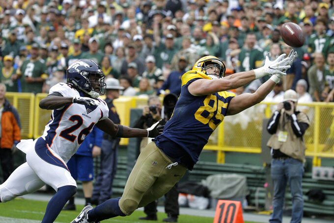 Green Bay Packers tight end Robert Tonyan (85) is unable to catch a pass as Denver Broncos cornerback Isaac Yiadom (26) defends during the first half of an NFL football game Sunday, Sept. 22, 2019, in Green Bay, Wis. (AP Photo/Mike Roemer)