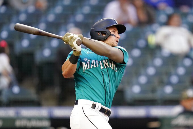 Seattle Mariners' Jarred Kelenic watches his two-run home run against the Cleveland Indians in the third inning of a baseball game Friday, May 14, 2021, in Seattle. (AP Photo/Elaine Thompson)