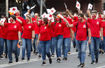 Red Cross volunteers take part in a parade to mark the Independence Day in downtown Skopje, North Macedonia, Wednesday, Sept. 8, 2021. North Macedonia is celebrating Wednesday the 30th anniversary since its independence from former Yugoslavia. (AP Photo/Boris Grdanoski)