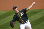 Oakland Athletics' Mike Minor pitches against the San Francisco Giants during the first inning of a baseball game in Oakland, Calif., Sunday, Sept. 20, 2020. (AP Photo/Jeff Chiu)