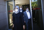 Hatice Cengiz, the fiancee of slain Saudi journalist Jamal Kashoggi, walks outside a court in Istanbul, Friday, July 3, 2020, where the trial in absentia of two former aides of Saudi Crown Prince Mohammed bin Salman and 18 other Saudi nationals over the 2018 killing of the Washington Post columnist had began. Turkish prosecutors have indicted the 20 Saudi nationals over Khashoggi's grisly killing at the Saudi Consulate in Istanbul that cast a cloud of suspicion over Prince Mohammed and are seeking life prison terms for defendants who have all left Turkey. Saudi Arabia rejected Turkish demands for the suspects' extradition and put them on trial in Riyadh.(AP Photo/Emrah Gurel)