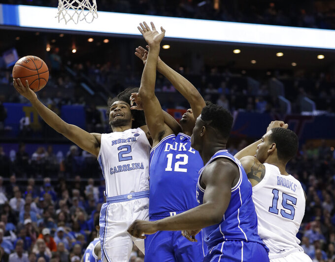 North Carolina's Coby White (2) grabs a rebound against Duke during the first half of an NCAA college basketball game in the Atlantic Coast Conference tournament in Charlotte, N.C., Friday, March 15, 2019. (AP Photo/Nell Redmond)