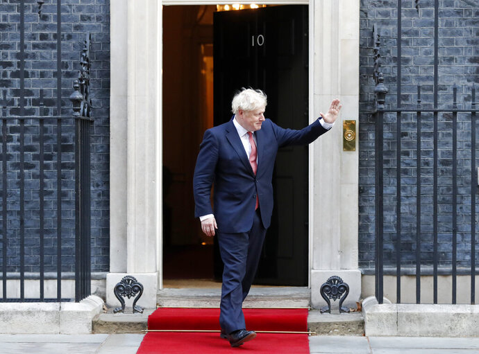 Britain's Prime Minister Boris Johnson waves to welcome the Emir of Qatar, Sheikh Tamim bin Hamad Al Thani at 10 Downing Street in London, Friday, Sept. 20, 2019 for bilateral talks. (AP Photo/Frank Augstein)