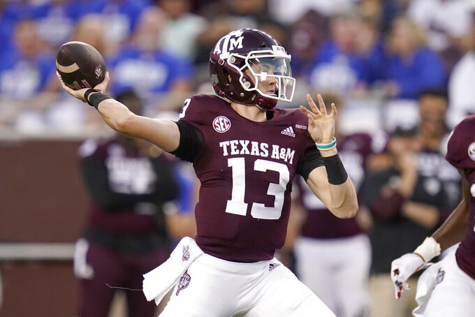 Texas A&M quarterback Haynes King (13) passes downfield against Kent State during the first half of an NCAA college football game on Saturday, Sept. 4, 2021, in College Station, Texas. (AP Photo/Sam Craft)