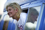 Republican April Becker campaigns for the Nevada state senate from a converted ice cream truck Thursday, Oct. 15, 2020, in Las Vegas. Becker is running against incumbent state Senate Majority Leader Nicole Cannizzaro. (AP Photo/John Locher)