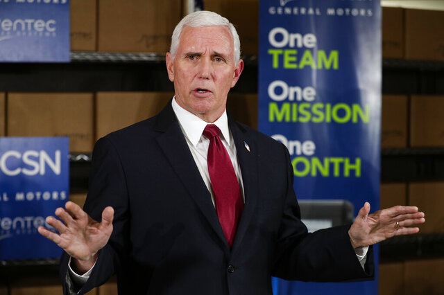 Vice President Mike Pence takes questions following a visits to the General Motors/Ventec ventilator production facility in Kokomo, Ind., Thursday, April 30, 2020. (AP Photo/Michael Conroy)