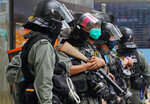 Riot Police stand guard at Central during the second day of debate on a bill that would criminalize insulting or abusing the Chinese anthem in Hong Kong, Thursday, May 28, 2020. (AP Photo/Vincent Yu)