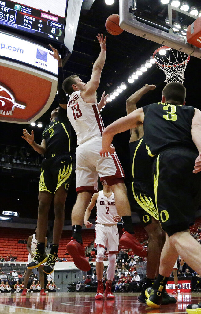 Washington State forward Jeff Pollard (13) shoots between Oregon forward Louis King (2), guard Payton Pritchard (3) and forward Francis Okoro during the first half of an NCAA college basketball game in Pullman, Wash., Wednesday, March 6, 2019. (AP Photo/Young Kwak)
