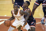 Texas guard Andrew Jones (1) tries to shake off Sam Houston State guard Demarkus Lampley (3) during the first half of an NCAA college basketball game, Wednesday, Dec. 16, 2020 in Austin, Texas. (Ricardo B. Brazziell/Austin American-Statesman via AP)