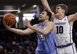 Columbia guard Gabe Stefanini, left, drives to the basket past Northwestern forward Miller Kopp during the first half of an NCAA college basketball game Sunday, Dec. 30, 2018, in Evanston, Ill. (AP Photo/Nam Y. Huh)