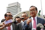 Cambodia's exiled opposition leader Sam Rainsy talks to the media outside Parliament House in Kuala Lumpur, Malaysia, Tuesday, Nov. 12, 2019. Rainsy landed in Kuala Lumpur in a bid to return to his homeland after Thailand had earlier blocked him from entering. (AP Photo/Vincent Thian)